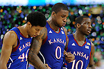 2 APR 2012: Teammates Kevin Young (40), Thomas Robinson (0) and Tyshawn Taylor (10) from the University of Kansas head off the court following their loss at the Championship Game of the 2012 NCAA Men's Division I Basketball Championship Final Four held at the Mercedes-Benz Superdome hosted by Tulane University in New Orleans, LA. Kentucky defeated Kansas 67-59 to claim the championship title. Ryan McKeee/ NCAA Photos.