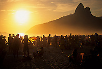 "Sunset at Ipanema beach, Rio de Janeiro, Brazil. Ipanema gained fame with the start of the bossa nova sound, when its residents Antônio Carlos Jobim and Vinícius de Moraes created their ode to their neighborhood, ""Girl from Ipanema."" The song was written in 1962, with music by Jobim and Portuguese lyrics by de Moraes with English lyrics written later by Norman Gimbel. The beach is famously known for its elegance and social qualities."
