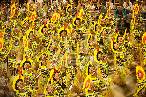 Imperatriz Leopolinense Samba School, Carnival, Rio de Janeiro, Brazil, 26th February 2017. Samba school percussion section, each bearing a mask of Raoni to represent the fight of the forest.