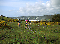 Bike Riders on the Headlands with Mendocino in the background, Mendocino, California
