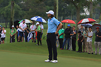 Tommy Fleetwood (Europe) on the 1st green during the Saturday Foursomes of the Eurasia Cup at Glenmarie Golf and Country Club on the 13th January 2018.<br /> Picture:  Thos Caffrey / www.golffile.ie