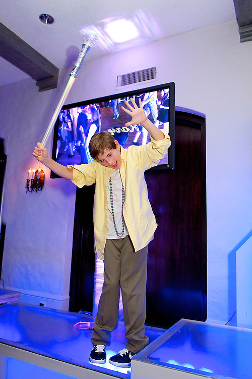 Bar Mitzvah boy dancing with lightsaber.