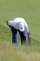 Patrick Reed (USA) looks for his ball in the rough on the 12th hole during the 118th U.S. Open Championship at Shinnecock Hills Golf Club in Southampton, NY, USA. 17th June 2018.<br /> Picture: Golffile | Brian Spurlock<br /> <br /> <br /> All photo usage must carry mandatory copyright credit (&copy; Golffile | Brian Spurlock)