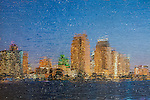 Creative photograph of San Diego skyline at dusk.  Taken under textured glass