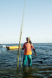 MAURITIUS, portrait of a fishermen with a bunch of handmade bamboo fishing rods, following a lond day on the water, Bel Ombre, Indian Ocean