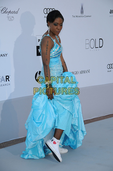 "SUZANNE ENGO.arrivals at amfAR's Cinema Against AIDS 2010 benefit gala at the Hotel du Cap, Antibes, Cannes, France during the Cannes Film Festival.20th May 2010.amfAR full length long maxi blue dress showing converse trainers tattoo writing words arm sleeveless ""I have a dream"" .CAP/CAS.©Bob Cass/Capital Pictures."
