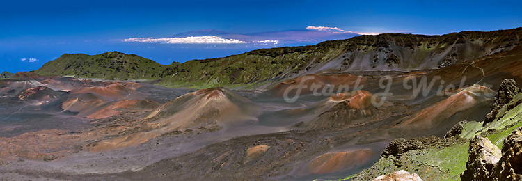 This is the iconic image of the crater which is the essence of HALEAKALA NATIONAL PARK on Maui in Hawaii on an absolutely beautiful day with the peaks of Mauna Loa and Mauna Kea on the Big Island clearly visible