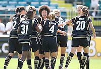 Eriko Arakawa, center, is congratulated after her goal by teammates. FC Gold Pride defeated the Boston Breakers 2-1 at Buck Shaw Stadium in Santa Clara, California on April 5th, 2009.