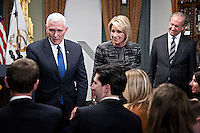 United States Vice President Mike Pence, from left, Betsy DeVos, U.S. secretary of education, and her husband Dick DeVos Jr. greet attendees after being sworn in in the Vice President's Ceremonial Office in Washington, D.C., U.S., on Tuesday, Feb. 7, 2017. DeVos squeaked through a history-making Senate confirmation vote to become U.S. education secretary, as Vice President Mike Pence broke a 50-50 tie and Republicans staved off last-minute defections that would have killed her nomination. Photo Credit: Andrew Harrer/CNP/AdMedia