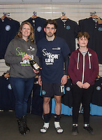 NHS Sign for Life present Max Kretzschmar of Wycombe Wanderers with a MOTM battle during the Sky Bet League 2 match between Wycombe Wanderers and Bristol Rovers at Adams Park, High Wycombe, England on 27 February 2016. Photo by Andy Rowland.