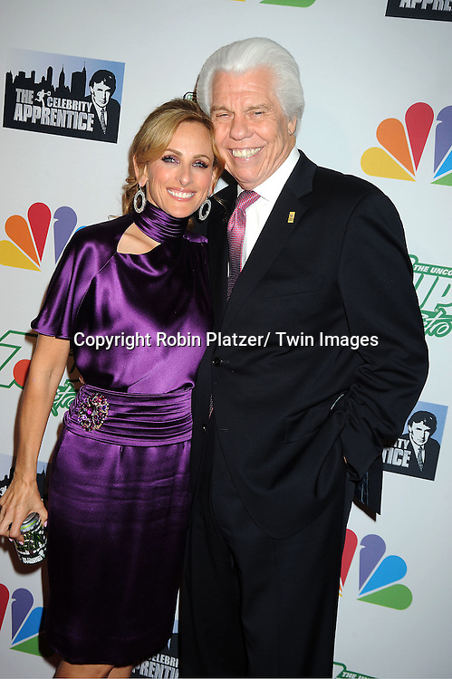 "Marlee Matlin and William Austin, Founder of Starkey Hearing Foundation posing for photographers at ""The Celebrity Apprentice"".Season Four Finale Party on May 22, 2011 at The Trump Soho Hotel in New York City."