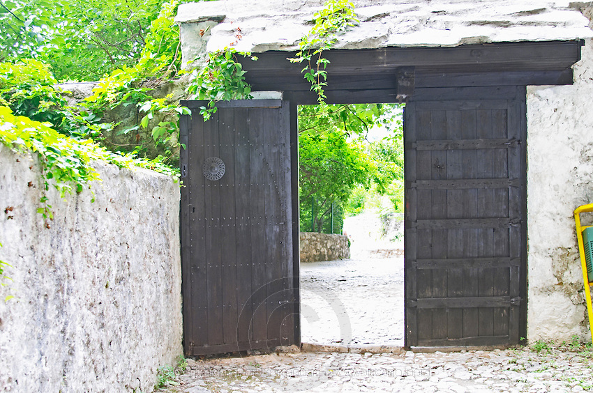 The heavy black entrance door gate. The source of the Buna river and the house of the Whirling Dervishes, an old Muslim monastery, Blagaj. Federation Bosne i Hercegovine. Bosnia Herzegovina, Europe.