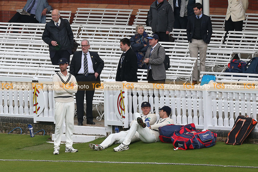 Middlesex players wait by the pavilion steps for the light to improve during Middlesex CCC vs Essex CCC, Specsavers County Championship Division 1 Cricket at Lord's Cricket Ground on 24th April 2017