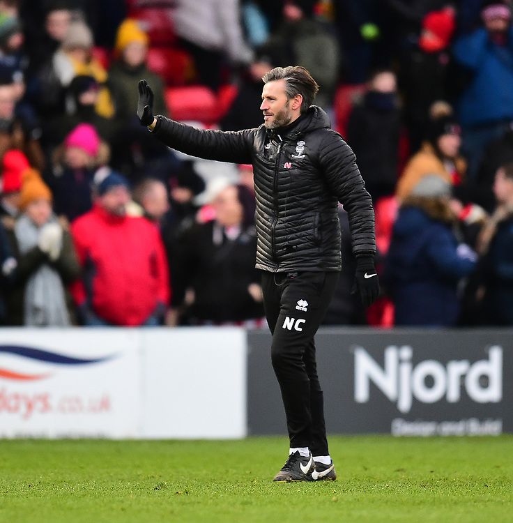 Lincoln City's assistant manager Nicky Cowley applauds the fans at the final whistle<br /> <br /> Photographer Andrew Vaughan/CameraSport<br /> <br /> The EFL Sky Bet League Two - Lincoln City v Grimsby Town - Saturday 19 January 2019 - Sincil Bank - Lincoln<br /> <br /> World Copyright © 2019 CameraSport. All rights reserved. 43 Linden Ave. Countesthorpe. Leicester. England. LE8 5PG - Tel: +44 (0) 116 277 4147 - admin@camerasport.com - www.camerasport.com