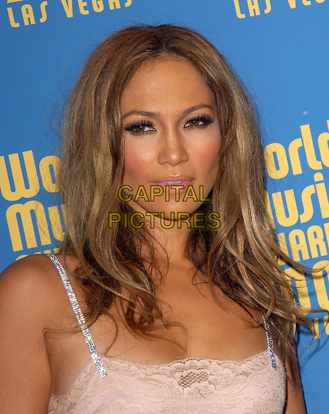 JENNIFER LOPEZ.15th Annual World Music Awards held at The Thomas & Mack Center in Las Vegas, Nevada .September 15,2004.headshot, portrait, lace, diamante straps, blusher, rouge, heavy make-up.www.capitalpictures.com.sales@capitalpictures.com. Copyright 2004 by Debbie VanStory