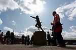 Sunderland fans carrying pints walk to the Bob Stokoe statue. Sunderland 2 Portsmouth 1, 17/08/2019. Stadium of Light, League One. Photo by Paul Thompson.