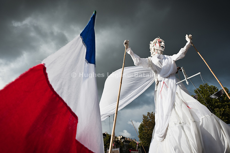 "Ariane Mnouchkine's famous ""Theatre du Soleil"" paraded a giant puppet symbolizing justice at the October 16 demonstration in Paris. .____________________________________________.2010 in France was marked by one of the largest social crisis as millions took to the streets during 3 months to oppose Sarkozy Government's reform of the pension law. The country came close to a standstill in October with gasoline shortage but before Christmas, the law was passed."