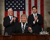 US Vice President Mike Pence (L) and Speaker of the House Paul Ryan (R) applaud as US President Donald J. Trump (C) arrives to deliver his first address to a joint session of Congress from the floor of the House of Representatives in Washington, DC, USA, 28 February 2017.  Traditionally the first address to a joint session of Congress by a newly-elected president is not referred to as a State of the Union.<br /> Credit: Jim LoScalzo / Pool via CNP