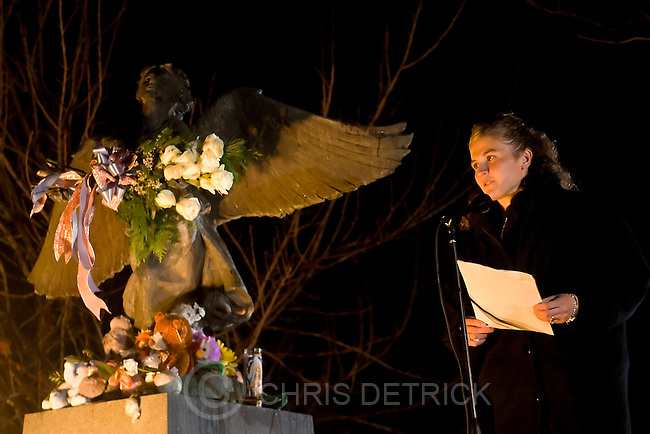 Salt lake City, UT --12/6/07--.Tara Adams speaks about her stillborn daughter Kylie during the 13th annual candlelight ceremony at the Christmas Box Angel of hope at the Salt Lake city cemetery...-------------------------------.Utah is participating in groundbreaking research on the prevalence and causes of stillbirth. Tara is part of the study. She lost a daugther in June. She will be speaking about it as part of an annual Christmas Box event at an angel statue...Photo by Chris Detrick/The Salt Lake Tribune.frame #_2CD9849