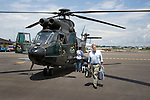 Peter Greenberg leaving helicopter on airfield in  Guyaquil, Ecuador