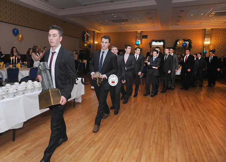 The team arrive to a rousing reception during the Clare U-21 hurling medal presentation night at the West County Hotel in Ennis. Photograph by Declan Monaghan