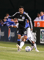 A.J. DeLaGarza (20) tries to steal the ball from Arturo Alvarez (10). San Jose Earthquakes tied Los Angeles Galaxy 1-1 at the McAfee Colisum in Oakland, California on April 18, 2009.