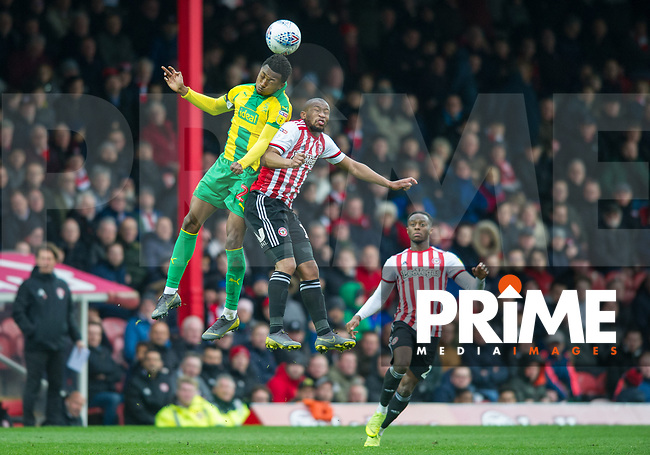 WBA's Allan Nyom and Brentford Kamohelo Mokotjo during the Sky Bet Championship match between Brentford and West Bromwich Albion at Griffin Park, London, England on 16 March 2019. Photo by Andrew Aleksiejczuk / PRiME Media Images.