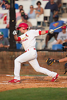 Paul DeJong (21) of the Johnson City Cardinals follows through on his swing against the Bristol Pirates at Howard Johnson Field at Cardinal Park on July 6, 2015 in Johnson City, Tennessee.  The Pirates defeated the Cardinals 2-0 in game one of a double-header. (Brian Westerholt/Four Seam Images)