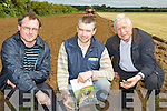 CHECKING: Desmond Shanahan (Spa), Niall Groves (Kielduff) and Sean Shanahan (The Spa) checking the soil after the reeseeding on Thursday at Kellihers Agri demoriation, at Brian Walsh Land on Friday morning.