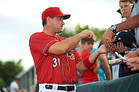 Harrisburg Senators first baseman Ryan Zimmerman (31), on a rehab assignment from the Washington Nationals, signs autographs before a game against the New Hampshire Fisher Cats on July 21, 2015 at Metro Bank Park in Harrisburg, Pennsylvania.  New Hampshire defeated Harrisburg 7-1.  (Mike Janes/Four Seam Images)