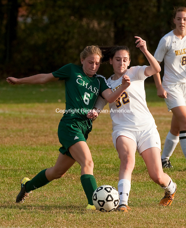 WATERBURY, CT--- -102115JS15---Chase's Malina Lacapra (6)  and Ethel Walker's Caroline Castonguay (23) collide while both going for the ball during their game Wednesday at Chase Collegiate School in Waterbury. <br /> Jim Shannon Republican-American