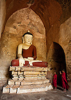 Two monks in front of a Buddha statue in the Sulamani pagoda, Bagan, Myanmar