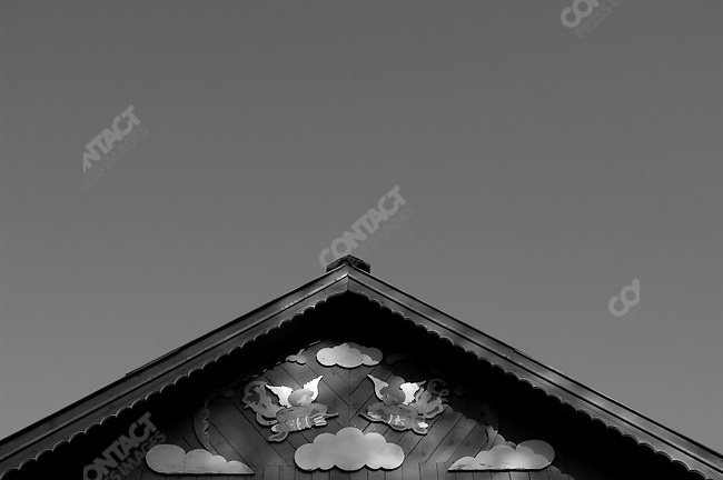 Wooden angels adorned the wooden front of a house in the village of Petrushovo in Ryazansk region, an individual decoration sometimes found on old-style Russian village houses. Russia, May 3, 2008.