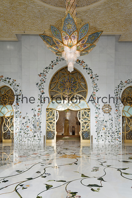 The Sheikh Zayed Grand Mosque in Abu Dhabi, also known as the White Mosque, is a masterpiece of architecture and craftsmanship. Inlaid in marble, the desert plant Pergularia Tomentosa by British artist Kevin Dean clambers over the doorway and floor in the entrance to the main prayer hall.