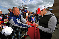 Kasey Kahne signs an autograph for a fan.