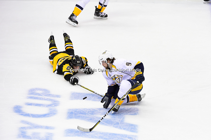 June 8, 2017: Pittsburgh Penguins center Scott Wilson (23) and Nashville Predators center Filip Forsberg (9) both play the puck at ice level during game five of the National Hockey League Stanley Cup Finals between the Nashville Predators  and the Pittsburgh Penguins, held at PPG Paints Arena, in Pittsburgh, PA. Pittsburgh defeats Nashville 6-0 to lead the series 3-2. Eric Canha/CSM