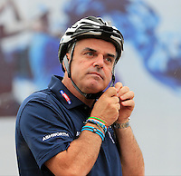 Paul McGinley (IRL) gets his helmet on for the BMW i8 challenge during Wednesday's Pro-Am Day of the 2014 BMW Masters held at Lake Malaren, Shanghai, China 29th October 2014.<br /> Picture: Eoin Clarke www.golffile.ie