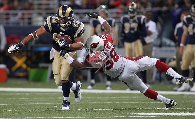 112711tvgotcha.Arizona Cardinals LB Daryl Washington (58) dives after Rams TE Lance Kendricks (88) as he carries the ball in the third quarter. The Arizona Cardinals defeated the St. Louis Rams 23-20 in a game on Sunday November 27, 2011 at the Edward Jones Dome in downtown St. Louis..TIM VIZER/BELLEVILLE NEWS-DEMOCRAT