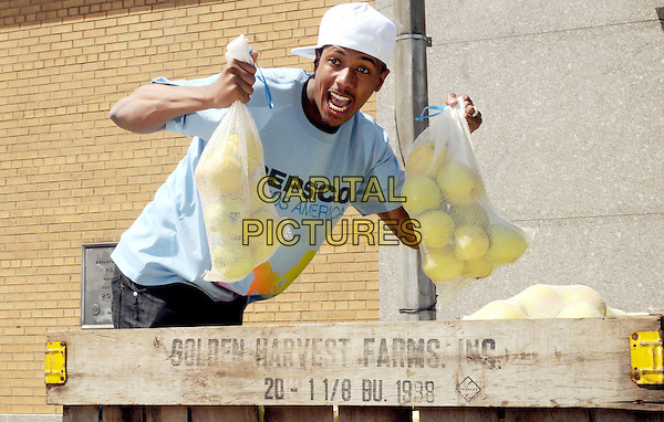 NICK CANNON.PepsiCo & Feeding America Day Of Service At City Harvest, New York, NY, USA..April 20th, 2010.half length bag bags mouth open funny  fruit food apple apples blue t-shirt white baseball cap hat goatee facial hair .CAP/ADM/BM.©Bill Menzel/AdMedia/Capital Pictures.