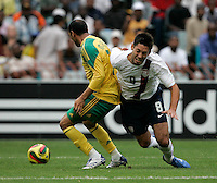 South Africa's Nasief Morris brings down the USA's Clint Dempsey during first half action between the national teams of South Africa (RSA) and the United States (USA) in an international friendly dubbed the Nelson Mandela Challenge at Ellis Park Stadium in Johannesburg, South Africa on November 17, 2007.