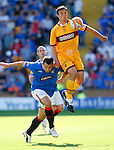 John Sutton rises above Lee McCulloch