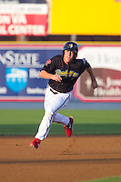 Brock Stassi (28) of the Reading Fightin Phils hustles towards third base against the Akron Rubber Ducks at FirstEnergy Stadium on June 19, 2014 in Wappingers Falls, New York.  The Rubber Ducks defeated the Fightin Phils 3-2.  (Brian Westerholt/Four Seam Images)
