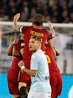 Lazio s Ciro Immobile, foreground, leaves the pitch as Roma players celebrate at the end of the Italian Serie A football match between Roma and Lazio at Rome's Olympic stadium, 18 November 2017. Roma won 2-1.<br /> UPDATE IMAGES PRESS/Riccardo De Luca