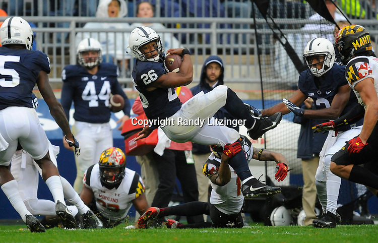 08 October 2016:  Penn State RB Saquon Barkley (26) does a mid-air 360 degree spin move to avoid a tackle during a run. The Penn State Nittany Lions defeated the Maryland Terrapins 38-14 at Beaver Stadium in State College, PA. (Photo by Randy Litzinger/Icon Sportswire)