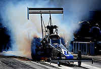 Sept. 17, 2010; Concord, NC, USA; NHRA top fuel dragster driver Pat Dakin does a burnout during qualifying for the O'Reilly Auto Parts NHRA Nationals at zMax Dragway. Mandatory Credit: Mark J. Rebilas/
