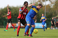 Nick Reynolds of Romford and Dexter Peter of Coggeshall during Romford vs Coggeshall Town, Bostik League Division 1 North Football at Rookery Hill on 13th October 2018