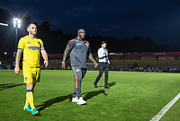 Barry Fuller, Captain of AFC Wimbledon leaves the field with Adebayo Akinfenwa of Wycombe Wanderers during the Friendly match between Wycombe Wanderers and AFC Wimbledon at Adams Park, High Wycombe, England on 25 July 2017. Photo by Andy Rowland.
