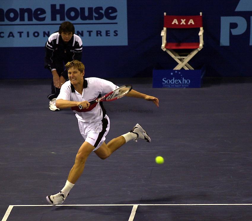 Photo. Richard Lane.ATP Tour AXA Cup Final, London Docklands. 27/2/2000.Kafelnikoev v Rosset.Yevgeny Kafelnikov returns to Marc Rosset.