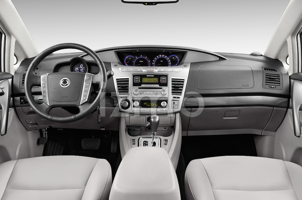 Stock photo of straight dashboard view of 2014 Ssangyong Rodius Sapphire 5 Door Minivan Dashboard