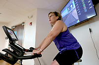 NWA Democrat-Gazette/DAVID GOTTSCHALK Fitness instructor Bobbi Boyd leads Friday, June 7, 2019, a Cycle by Color cycle class at the Jones Center in Springdale. The class lasted 30 minutes.